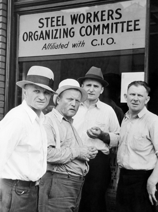 Pennsylvania --- 1938-Pennsylvania:  Pennsylvania Steel workers in front of CIO Headquarters. --- Image by © Bettmann/CORBIS