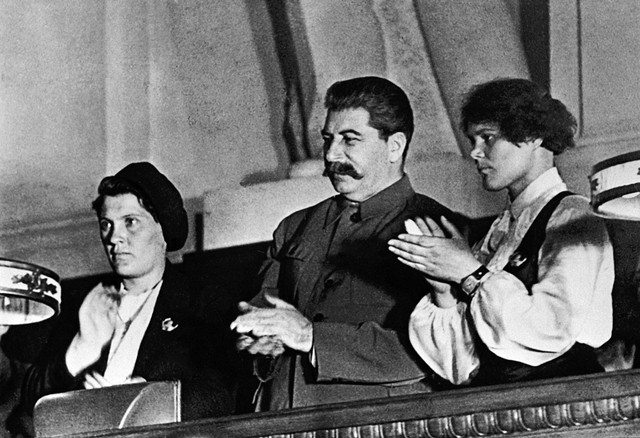 RIAN archive 377427 Stalin and famous collective farmers Demchenko and Angelina at the X Congress of the Young Communist League